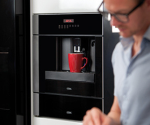 built-in black coffee machine with red cup