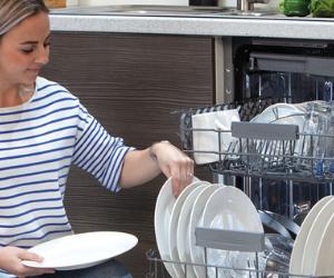 Woman unloading CDA dishwasher