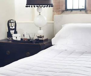 Dreamland heated mattress protector on bed