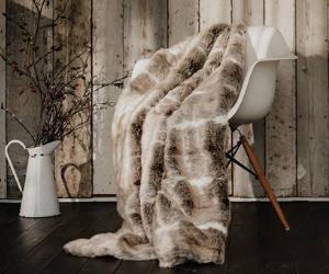 Dreamland brown faux fur heated throw on chair