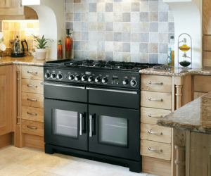 Falcon black range cooker in oak kitchen