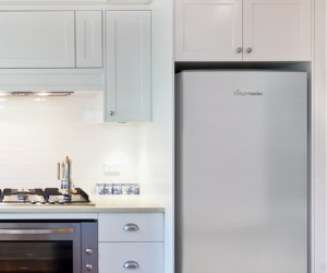 Tall silver fridge freezer in kitchen
