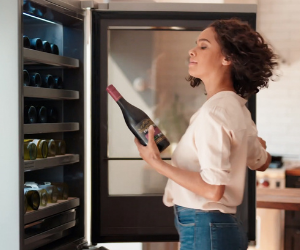 LG wine cooler with lady choosing a bottle