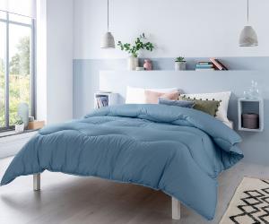 Blue Night Owl coverless duvet on double bed