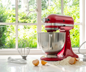 KitchenAid red stand mixer with dough attachment