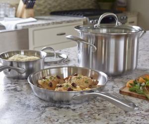 KitchenAid stainless steel cookware pan set on worktop
