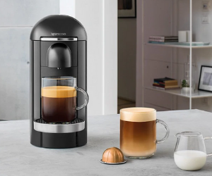Black Nespresso vertuo coffee machine with full glass